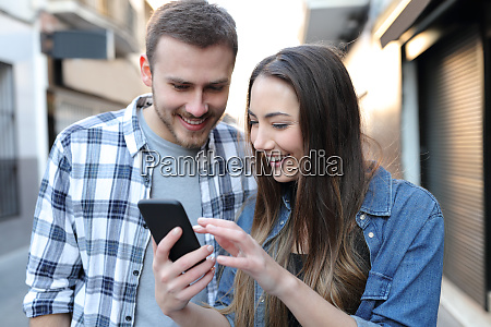 couple are checking smart phone content