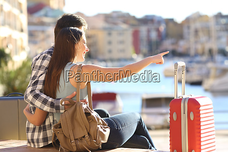 couple of tourists pointing vacations destination