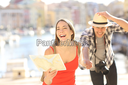 couple of tourists running in travel