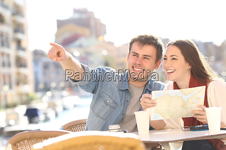 couple of tourists searching destination during