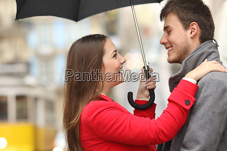 couple encounter in the street under