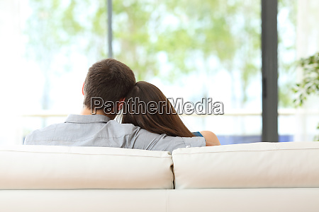 couple sitting on a couch looking