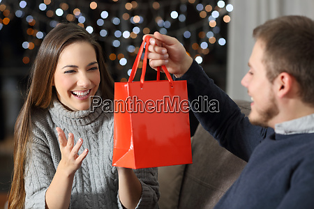partner or friend giving a gift