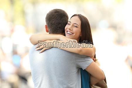 happy girlfriend hugging her partner after