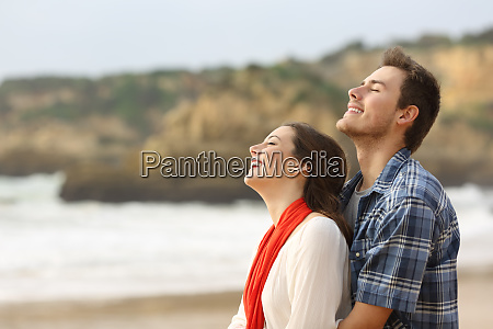 happy couple breathing fresh air together