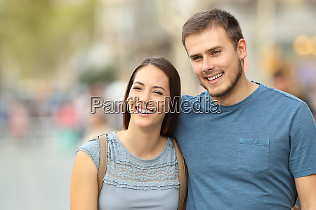 front view of a couple walking