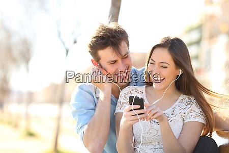 joyful couple listening to music from