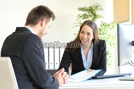 dealer attending to a customer