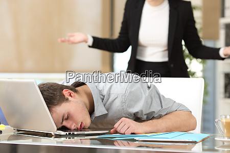 employee sleeping with boss watching