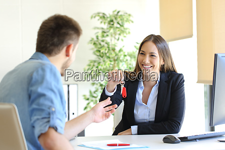 real estate agent giving house keys
