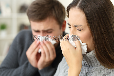ill couple coughing at home