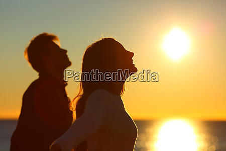silhouette of a couple of friends