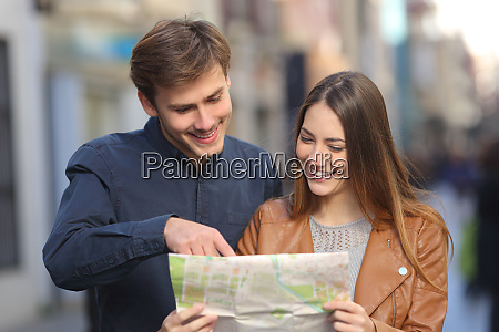 happy couple of tourists on vacation