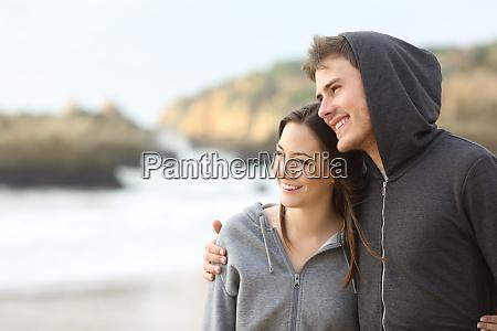 happy couple of teens hugging