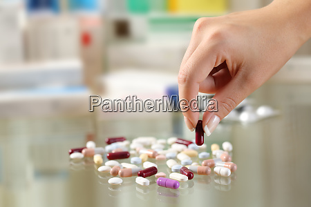 woman hand catching a pill from