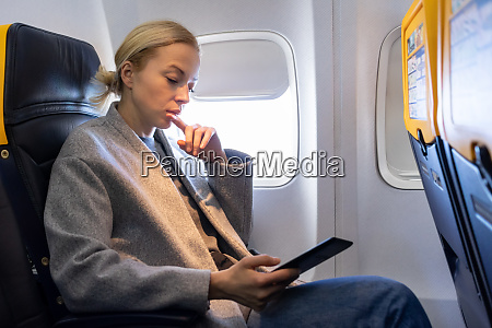 woman reading on digital e reader