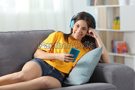 teen listening to music looking at
