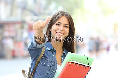 happy student posing with thumbs up