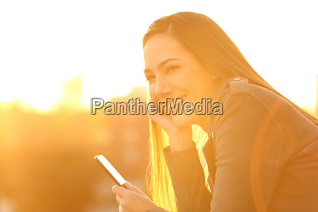 girl holding a smartphone looking at