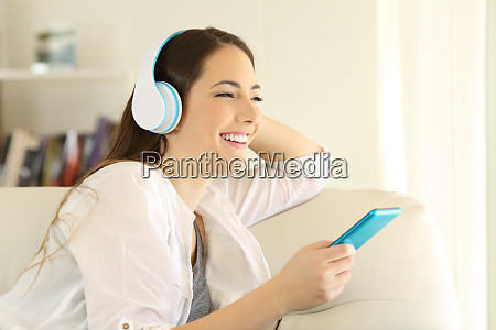 girl looking away listening to music