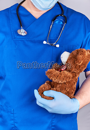 doctor in blue uniform and old