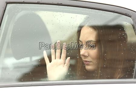 sad woman inside a car during