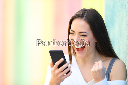 excited girl reading good news on