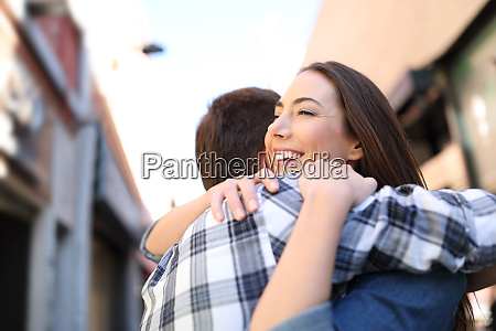 happy couple hugging after meeting in