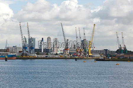 industrial ships in dock with rotterdam