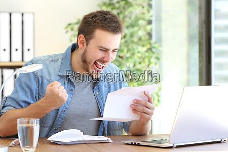 excited entrepreneur reading a letter
