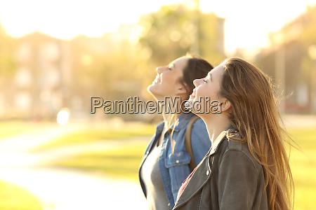 two girls breathing fresh air in