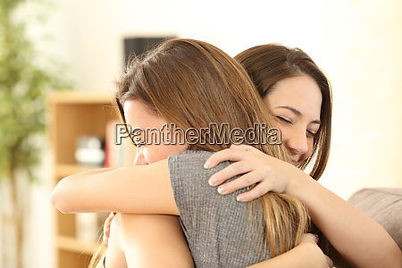 happy girls embracing at home