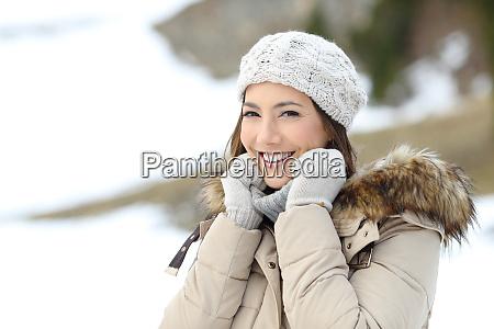 happy woman keeping warm in winter