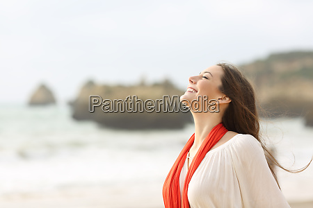 happy woman breathing deep on the