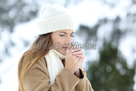 woman suffering cold outdoors in a