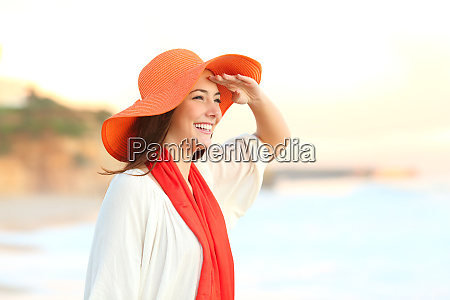 woman scouting in the beach with