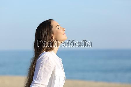 woman relaxing breathing fresh air on