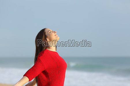 lady in red breathing fresh air