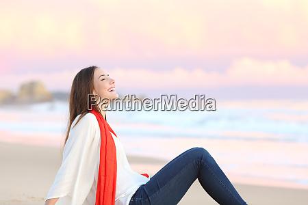 woman breathing fresh air at sunset