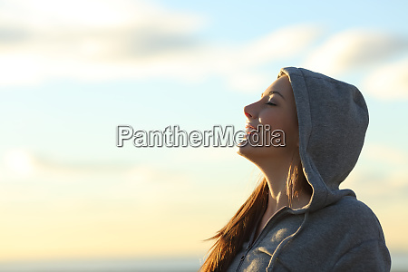 profile of a happy teen breathing