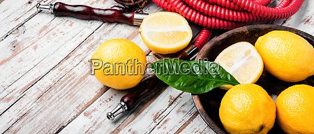 smoking hookah with lemon flavor
