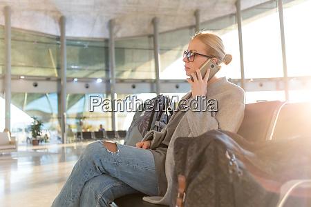 female traveler talking on her cell
