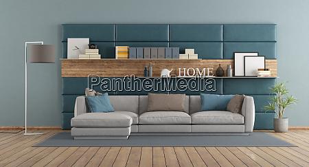 modernes wohnzimmer mit sofa gegen verkleidung