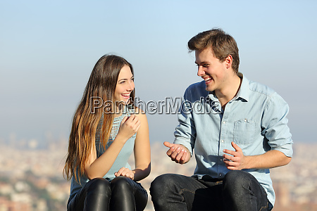 happy couple talking in a city
