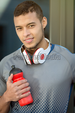 young latin man water bottle runner