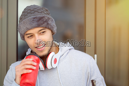 sports training young latin man drinking
