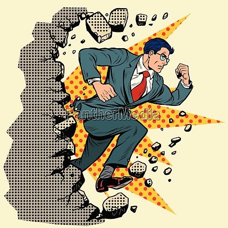 leader businessman breaks a wall destroys