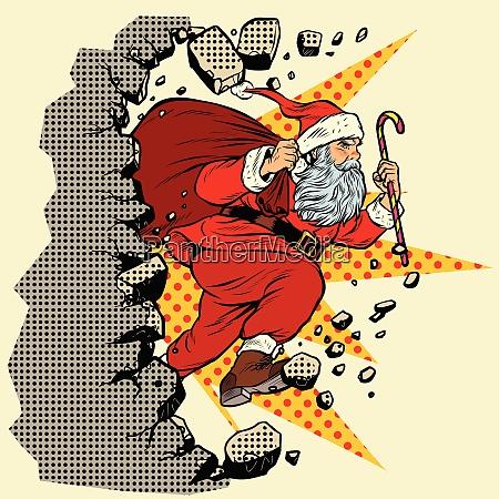 weihnachtsmann mit weihnachtsgeschenken bricht die wand