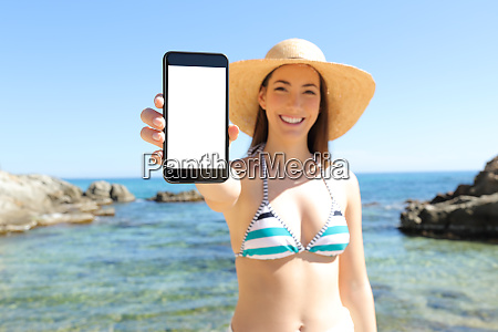 tourist showing blank vertical phone screen