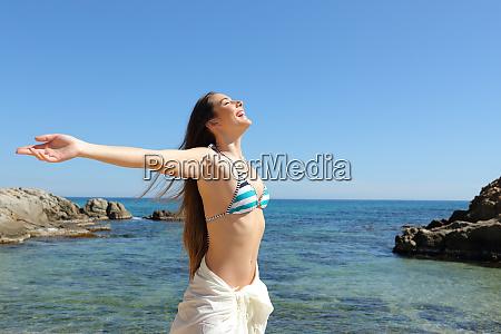 happy tourist celebrating vacation breathing fresh